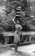 Philippines: Ifugao woman balancing pots on her head about to cross a bridge, Cordillera Administrative Region, Central Luzon, c. 1950